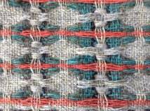 Detail of hand woven fabric in British Wool. Dye made from madder. Bradford Textile Society Design Competition